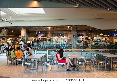 Customers Dining In The Food Court Of Orchard Road Shopping Mall, A Popular Shopping Destination In