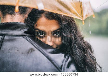 Lovers With Umbrella On A Rainy Day