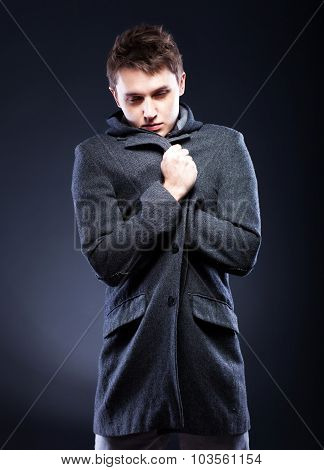 Young Man In Winter Clothes Shivering From Cold
