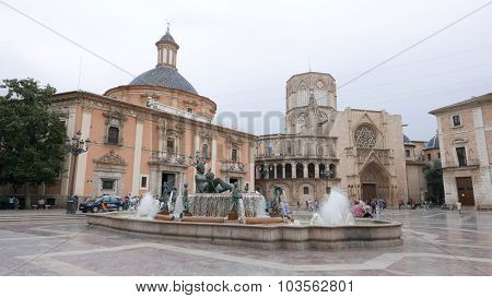 VALENCIA, SPAIN - OCTOBER 3, 2015: Tourist visiting the Plaza de la Virgen in Valencia. Valencia is the capital of the autonomous community of Valencia and the third largest city in Spain.