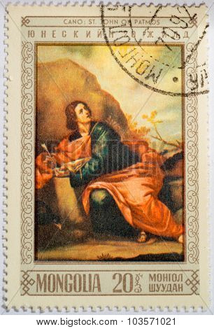 Moscow, Russia - October 3, 2015: A Stamp Printed By Mongolia, Shows Saint John On Patmos, By Cano,