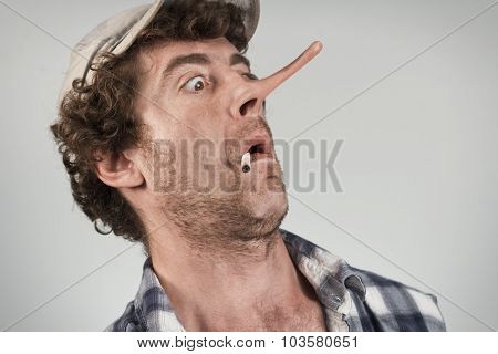 Shocked redneck jumps back in fear as his lying nose grows