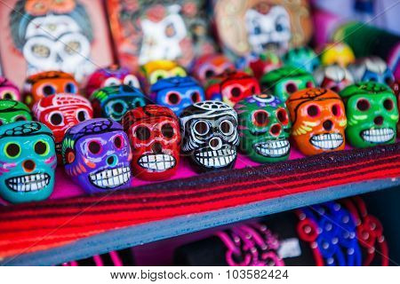 Colorful skulls souvenirs in Mexico on the market.