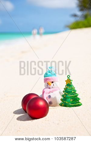 Snowman On The Sandy Sea Beach. Holiday Christmas Concept, Vertical Composition