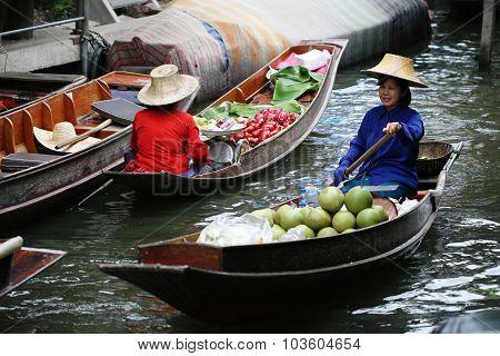 RATCHABURI THAILAND - JULY 5: Fruit boats at Damnoen Saduak floating market on July 5 2009 in Ratcha