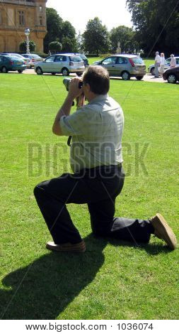 Photographer Taking Photo/Picture