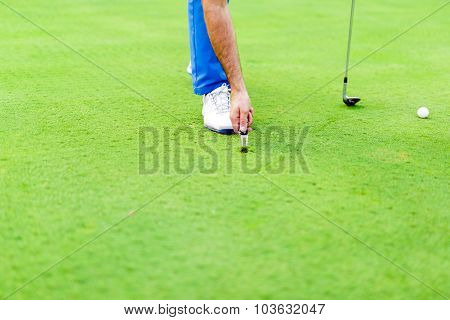 Golf Player Repairing Divot
