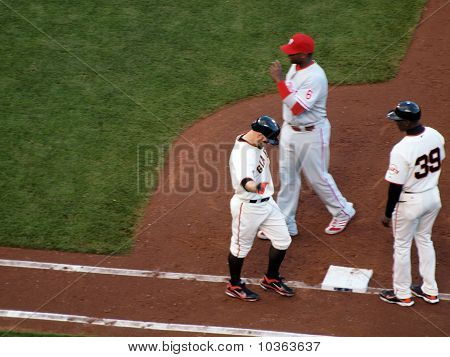 Cody Ross Reaches Out Arm As He Walks To 1St Base After He Was Hit By A Pitch