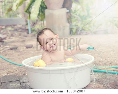 Baby Bathing Out Door , Baby Hand Holding The Hose Which Water Flow Out And He Is Wondering Of  Wate