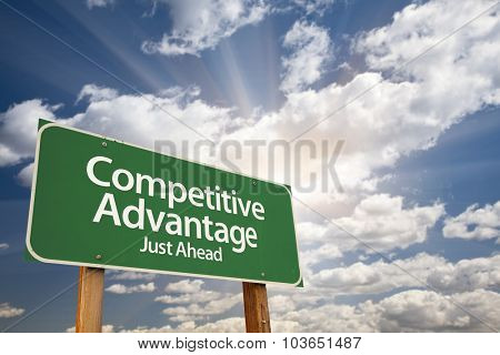 Competitive Advantage Green Road Sign With Dramatic Clouds and Sky.