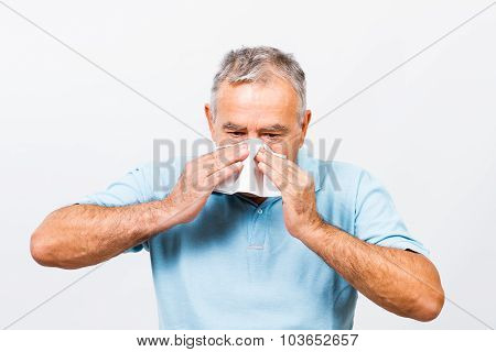 Senior man having flu