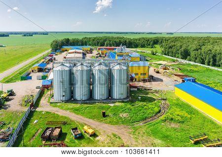 Corn dryer silos standing in machine yard
