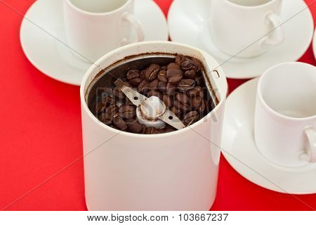 Grinding coffee beans with an electric mill to make coffee poster