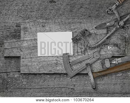 vintage jeweler tools and diamond over wooden bench, blank card for your business