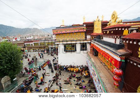 Pilgrims and locals are praying in front of Jokhang Temple in Lhasa, Tibet, China.