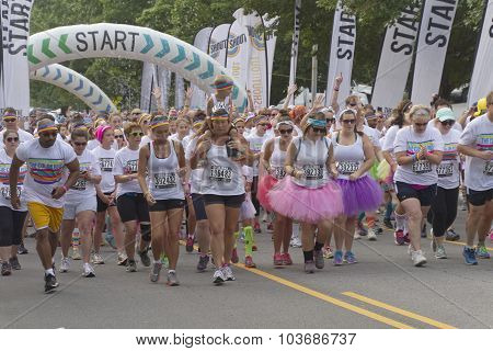 Color Run Racers Take Off From The Starting Line