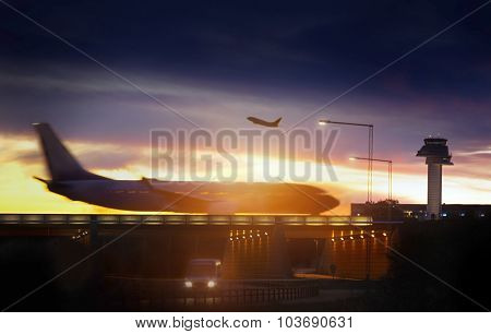 Airport airliner at dusk departure with control tower