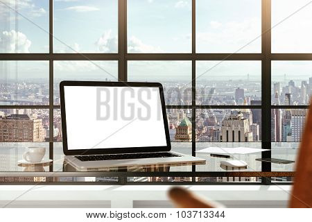Mock Up Of Blank Laptop On The Desk In Office With City View