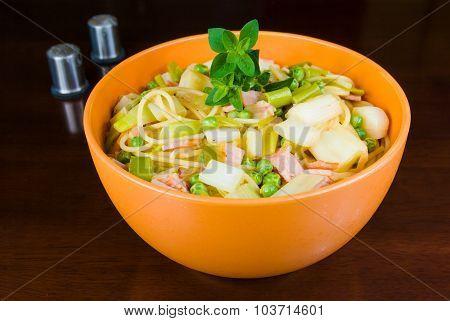 Pasta in orange bowl