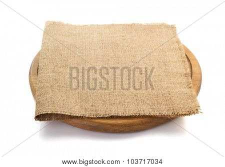 sack burlap napkin at cutting board on white background poster