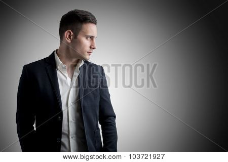 Attractive male model smiling and looking sideways