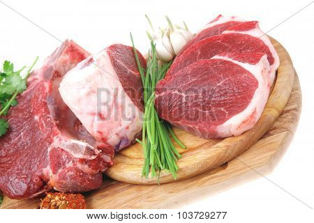 uncooked meat : raw fresh beef pork rib and fillet ready to cooking with garlic and green stuff over wood isolated on white background