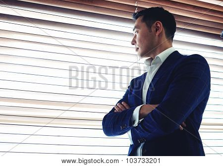 Successful managing director thinking about something before business meeting