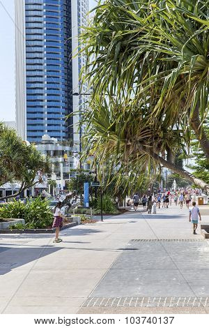 People walking along Gold Coast Surfers Paradise esplanade