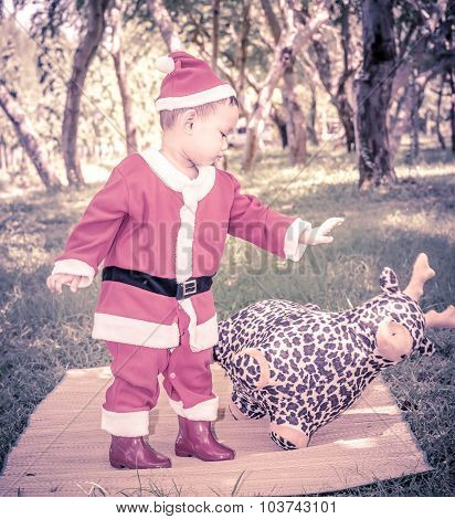 A Kid In Santaclaus Suit Push Reindeer Doll Away , Unfriend Concept