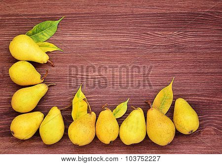 Group of Pears on the wooden ackground