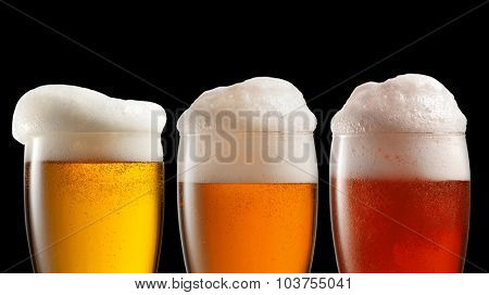 Different beer in glasses isolated on black background. Header for website