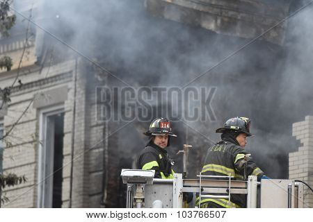 Fire fighters battle smoke
