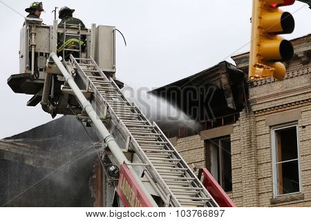 Fire fighters douse flames