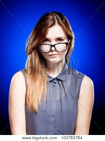 Focused Young Woman Looking Through Nerd Glasses