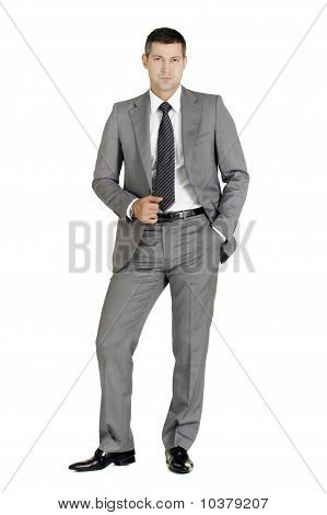 businessman with hand in pocket isolated on white background