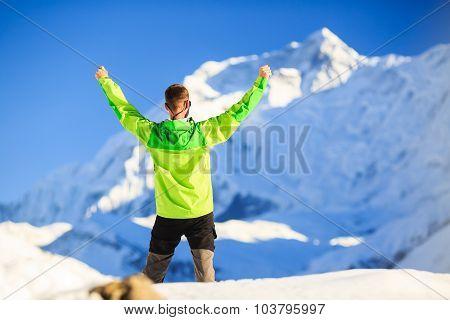 Man hiker or climber achievement in winter mountains inspiration and motivation achievement business