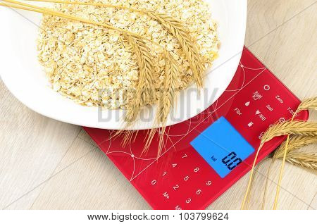 Dish Of Oatmeal On Electronic Kitchen Scales