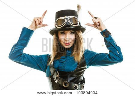 Young steampunk islolated girl on white wearing fancy hat. Fantasy old fashion with stylish topper and goggle pointing. poster