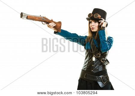 Young steampunk islolated girl on white adjusting fancy hat. Fantasy old fashion with stylish topper goggle and gun aiming. poster