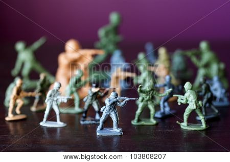 Toy soldiers and miniature figurine. Concept photo of world war conflict and warfare.