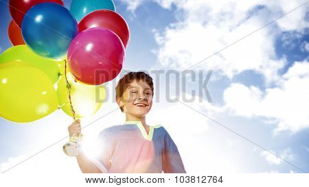 Happy Boy Outdoors Dozen Helium Balloons Playful Concept