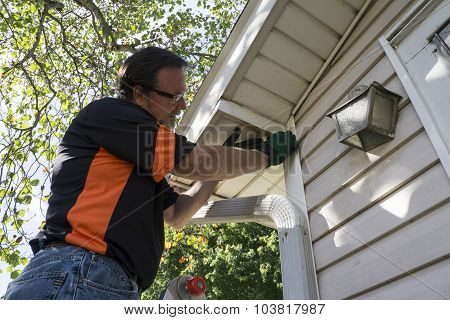 Contractor Fixing Vinyl Siding For Customer