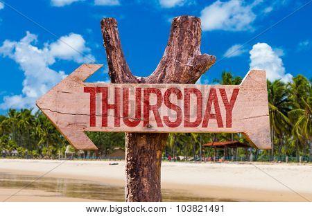 Thursday arrow with beach background