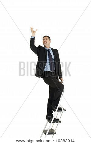 businessman on a ladder isolated on white background