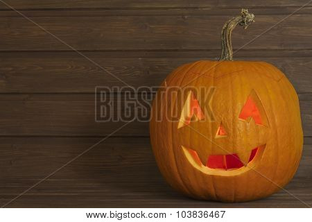 Halloween pumpkin head on wooden background. Preparing for Halloween.
