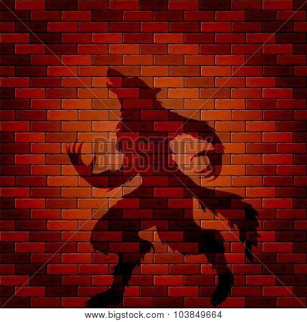 Shadow Of Werewolf On A Brick Wall