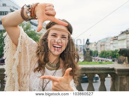 Happy Bohemian Woman Tourist Framing With Hands In Prague