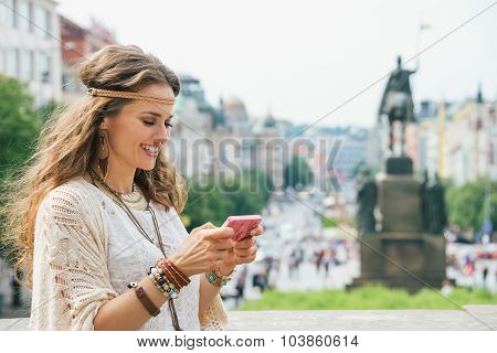 Longhaired Bohemian Young Lady Writing Sms On Mobile, Prague
