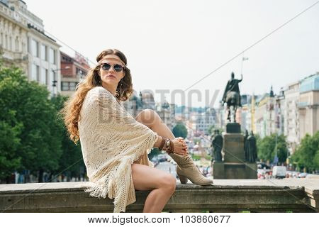 Woman In Boho Chic Clothes Relaxing On Stone Parapet In Prague