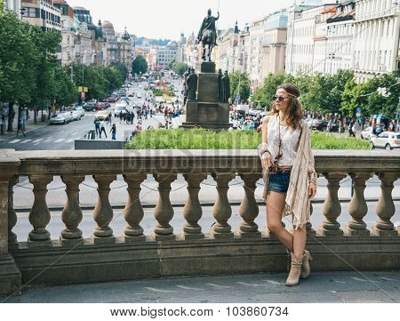 Trendy Hippie Woman Standing On Wenceslas Square In Prague